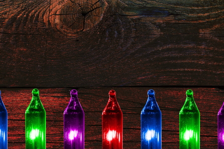 colorful flashing lights on wooden vintage background with copy space