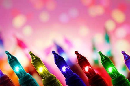 colorful flashing lights on glitter defocused background with copy space Stock Photo
