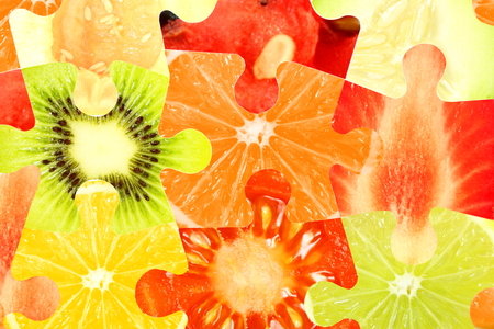 colorful mixed fruit slice puzzle as background 写真素材