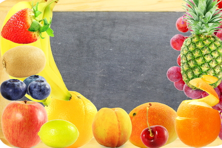 Fruit frame on blackboard background Healthy eating and dieting food concept with space for text