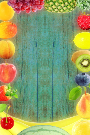 Fruit frame on wooden background Healthy eating and dieting food concept with space for text Standard-Bild