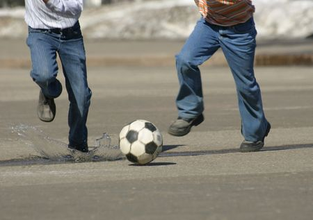 scamper: Children on the city area play football.