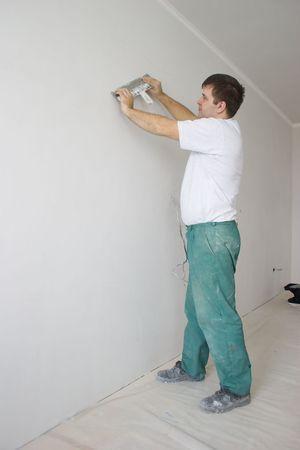 repairs: The man repairs an apartment