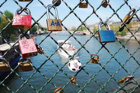 lacking: many people are lacking of love today, so they make a wish by locking lockers to the fence. Unfortunately, love in present days is a bond, blocking freedom... so they are all just burden of love ...flying nowhere Editorial