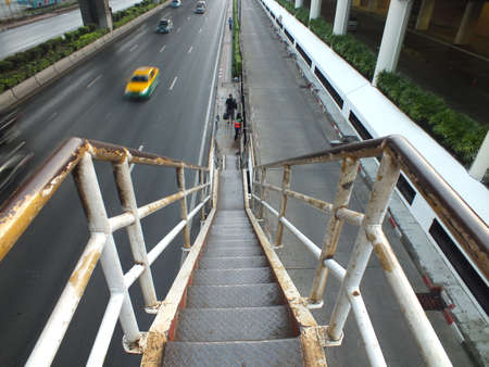 acrophobia: The path to the ground seems so scary, in the cty of Bangkok, where people from all regions of Thailand gather here to seek new life.