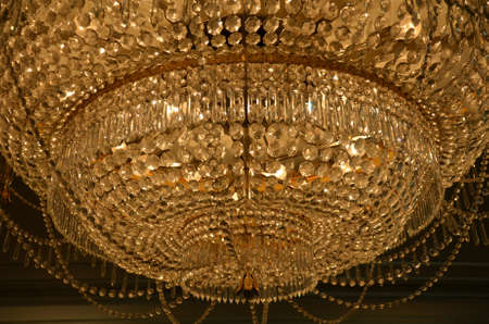 A closeup of crystal and decoreation from the chandelier photo