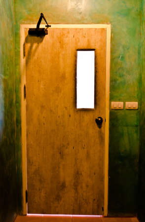 an old dirty exit from a mysterious room. where it will lead you? photo