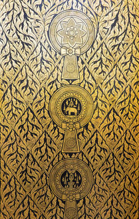 Golden pattern on the temple door of Thailand photo