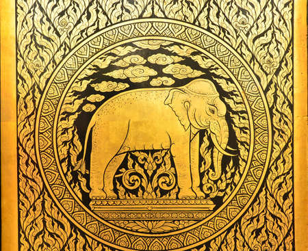ancient elephant: Golden pattern on the temple door of Thailand