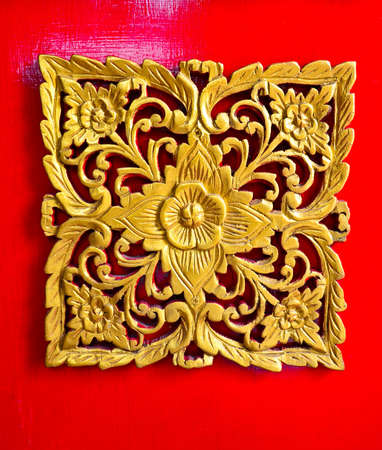 artistic flower: Golden perforated pattern at the gate of a Thai temple, in rural area  Stock Photo