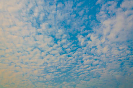 Blue sky with cloudy patterns photo