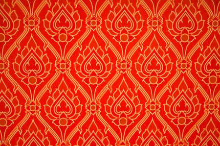 Red Thai-art wallpaper with a nice lotus pattern photo