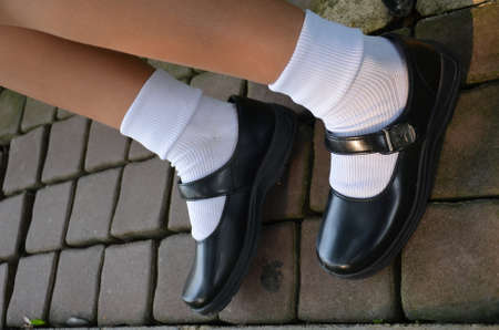 school girl sexy: Thai girl wears a black leather shoes as a school uniform.