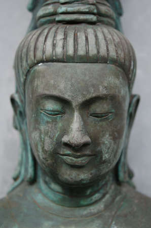 An ancient Buddha statue showing peaceful expression  Stock Photo - 12449686