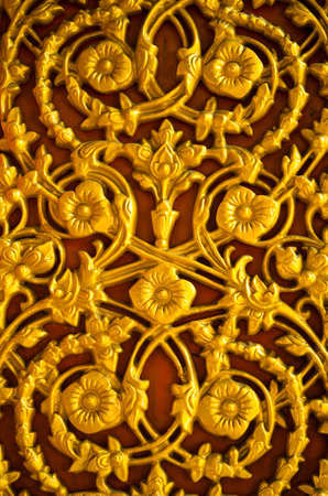 bas relief: Golden flower pattern on the temple