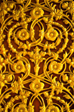 wood carving door: Golden flower pattern on the temple