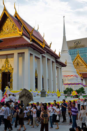 deeds: Wat Patum Temple, center of Bangkok  7 March 2012. This is an important day for Buddhists all over the world. In Thailand people visit the temple to do merit at the temple near their home, devoting themselves for good deeds and mind. Here is one of the m