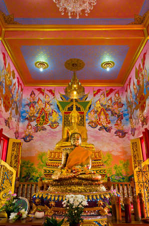 thai believe: Golden Buddha in an ancient temple hall in Bangkok, Thailand