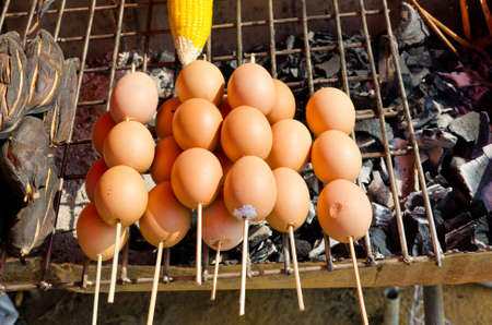 taro: Grilled egg and potato in Thai rural market