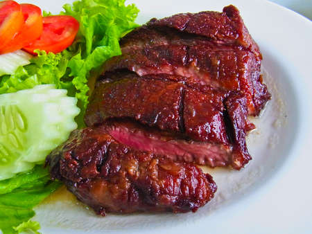 restuarant: Fried beef steak and Salad in Thai restuarant  A creative Thai cuisine