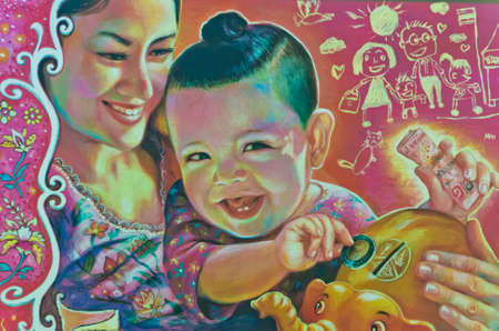 A picture of a mother who teach her child to be economize and save money representing Thai culture by Thai Government Saving Bank (GSB)