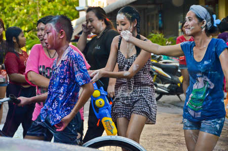 Bangkok  Thailand - 15 April 2012: Songkran is a very important Thai tradition. During that time everyone comes out of their house to enjoy the festival in the rural street, even for children, teens, and adults.