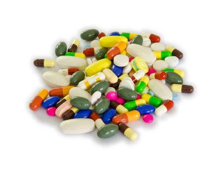 drogadiccion: Pila de p�ldoras en el fondo blanco de aislamiento