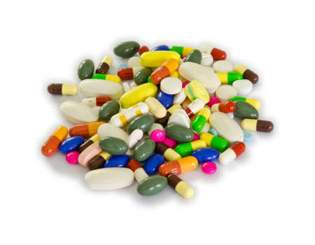 prescription drugs: Pile of pills in white isolation background