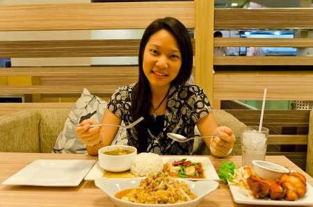 An asian (Thai) girl ready to eat her Thai cuisine meal. Stock Photo - 13655586