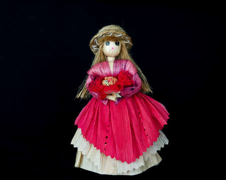 A woman doll, made of corn peel with black isolation background Stock Photo - 14035183