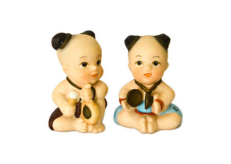 Thai medieval children doll playing native music with white isolated background. photo