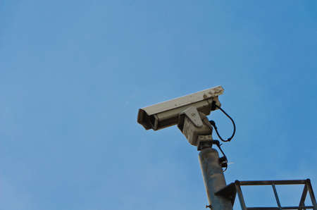 Security camera on the high ground with blue sky background photo