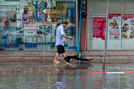 BANGKOK, THAILAND - SEPTEMBER 25: Heavy storm hit Bangkok and created a flood in the middle of the city on September 25, 2012.