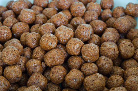 Pile of choco balls cereal in white background photo
