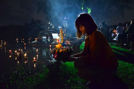 12 November 2012  Loy Kratong festival to worship river goddess in Thailand on a full moon day  People will put a lantern made of leaves in the water with respect and wish for success