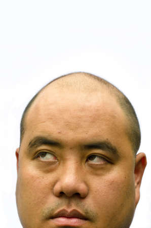 A bald head man glimpse up with white background  He looks tired with wrinkle photo
