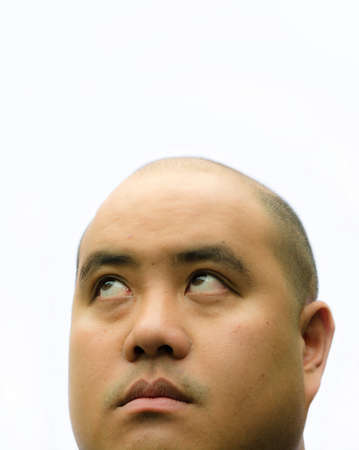 A bald head man glimpse up with white background photo