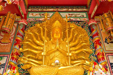quan yin: Shrine of Golden statue of Thousand-Hand Quan Yin Bodhisattva in Thailand. Stock Photo
