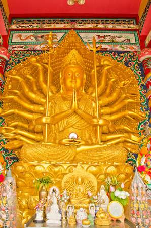Shrine of Golden statue of Thousand-Hand Quan Yin Bodhisattva in Thailand. photo