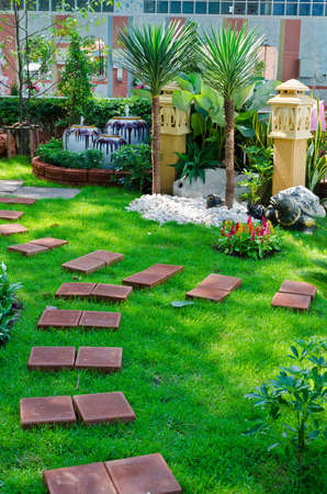 Nicely decorated garden with stones and plants Editorial