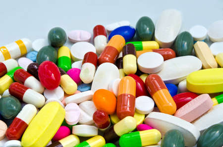 Pile of pills in white isolated background Stock Photo