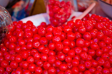 Cherry preserved in syrup on sell in Thailand open market photo