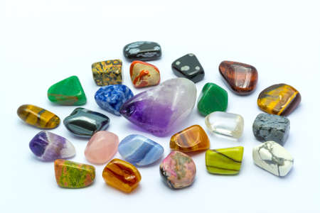 charm: Colorful stones and minerals in white backgrounds Stock Photo