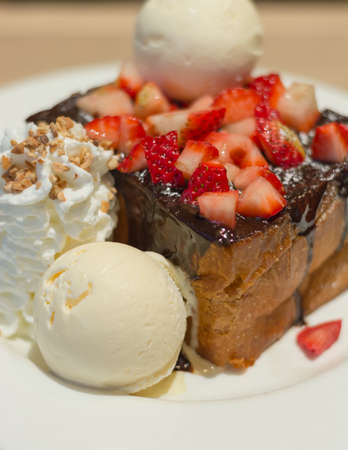 Decorated Honey Toast with chocolate lava and strawberry  photo