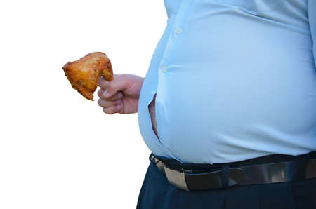 Fat man holding fried chicken with a fat stomach Stock Photo