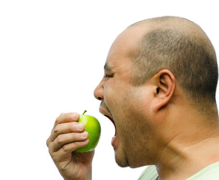 A fat man is forcing himself to eat an apple on white background Stock Photo - 18381493