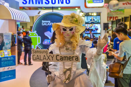 BANGKOK, THAILAND - DECEMBER 1: Samsung promotes Samsung Galaxy camera in Thailand Photo Fair with a doll-girl mascot on December 1, 2012.