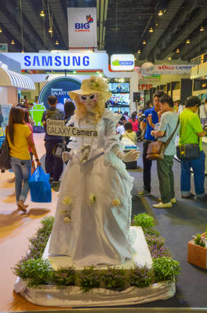 BANGKOK, THAILAND - DECEMBER 1: Samsung promotes Samsung Galaxy camera in Thailand Photo Fair with a doll-girl mascot on December 1, 2012. Stock Photo - 18369571