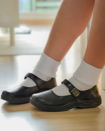 Thai girls wear a black leather shoes as a school uniform