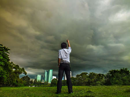 beyond: A man is on fire. Being mad at the cloudy sky. Will the heaven punish him? Stock Photo